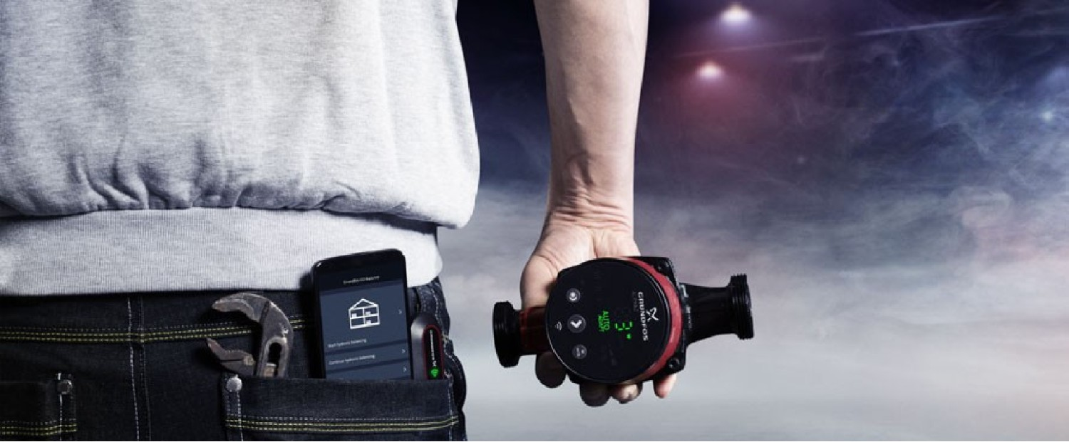 Grundfos Autoadapt in a contractor's hand