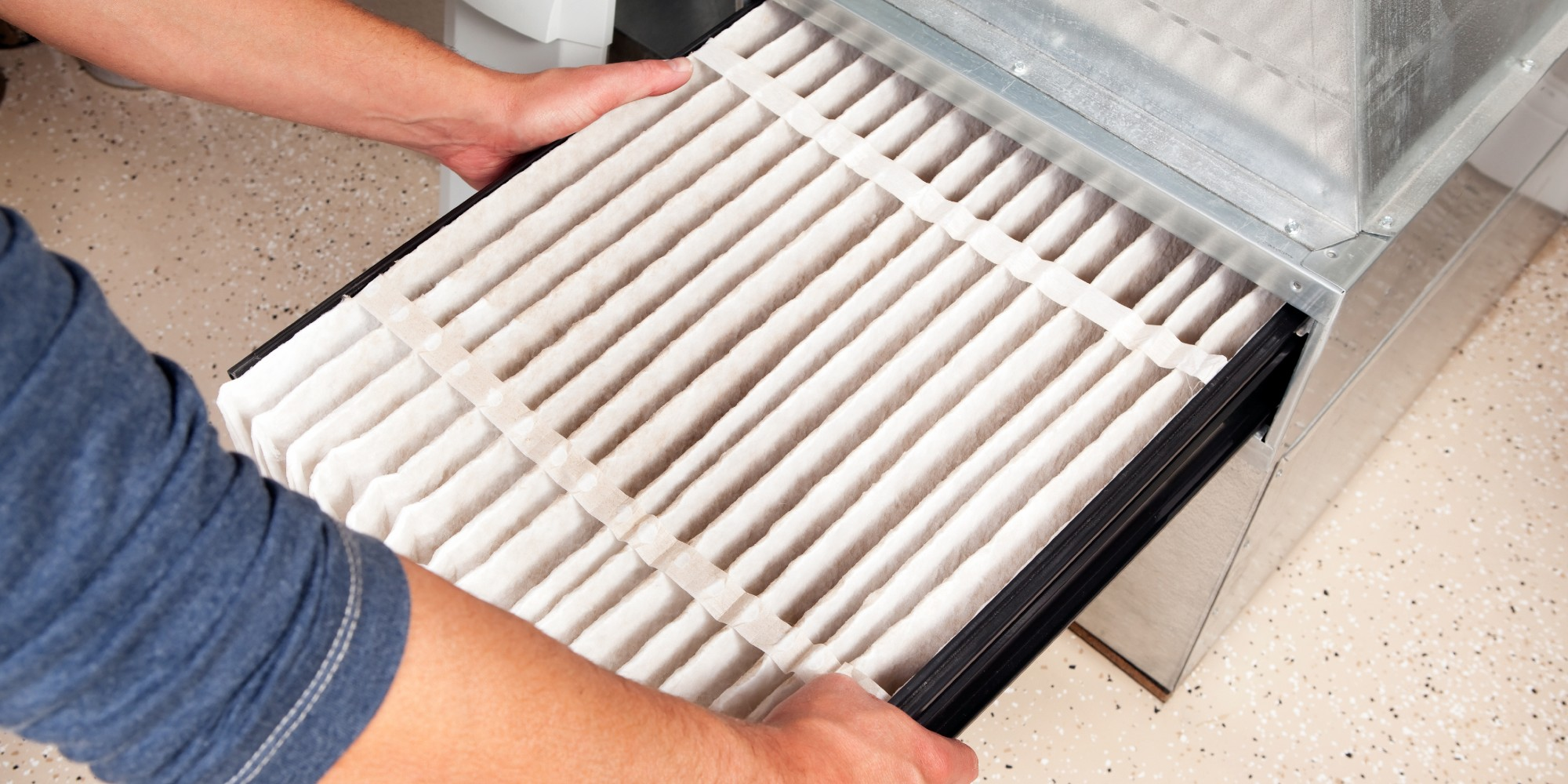 Wolseley PRO pipeline Blog person changing HVAC filter
