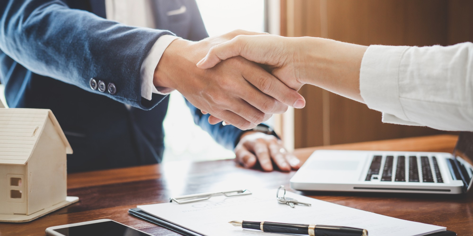 Real Estate Or Insurance Agent Shaking Hands With Client
