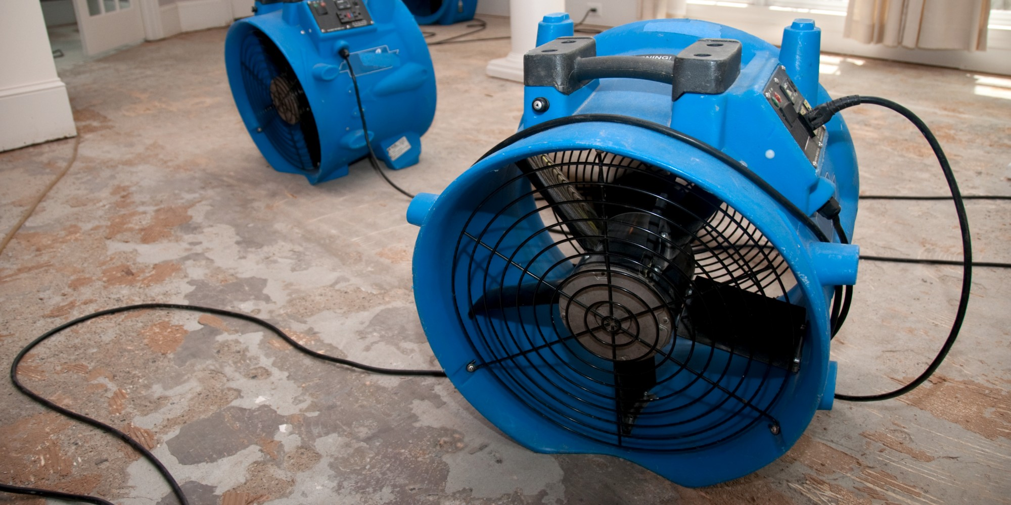 Industrial Fans Drying Out Home To Restore Water Damage
